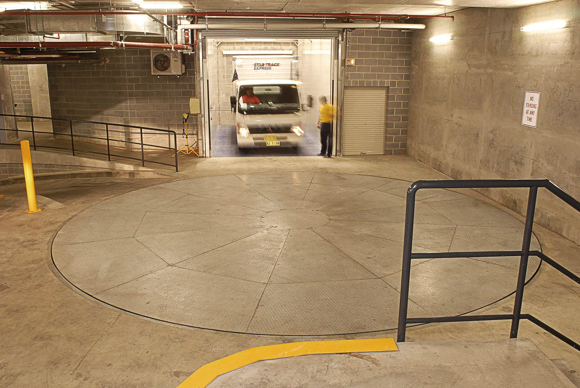 Light truck turntable improves loading dock in cbd retail for Car turntable plans